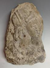 Antiquities - an Indonesian marble fragment, carved in relief with the head