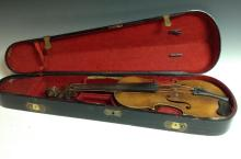 A violin, the two-piece back 36cm long excluding button, outlined throughou