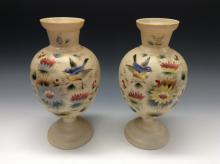 A pair of Victorian opaque glass pedestal vases, painted with birds and flo