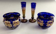 A pair of Bohemian Bristol Blue tapering bud vases, decorated with enamel i