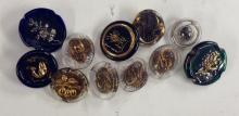 A set of four Bimini type oval glass buttons, gilded and cased;  a large gr