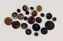 An assortment of Victorian, Edwardian and later black glass buttons, with c