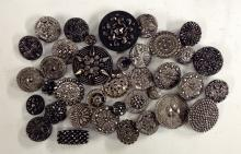 An assortment of Victorian, Edwardian and later black glass buttons, with s