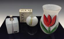 A Kosta Boda ovoid glass vase, brightly painted with red tulips, signed by