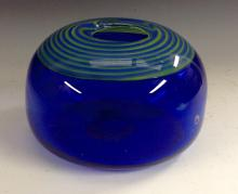 A studio glass compressed ovoid vase, blue glass cased in clear, the rim de