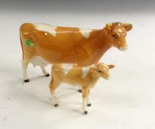 A Beswick Guernsey cow, model no.1248A;   a similar calf (2)