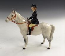 A Beswick Huntswoman, on grey, designed by Arthur Gredington, 21cm high, pr