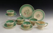 A Susie Cooper Dresden Spray part tea service, comprising four cups and sau