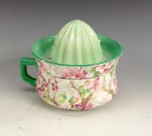 A Shelley Chintz Maytime pattern lemon juicer and squeezer, painted with co
