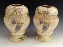 A pair of Doulton Burslem Mona pattern pedestal lobed ovoid vases, decorate