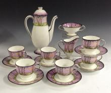 An Art Deco Royal Doulton Pollards Willow coffee service for six, painted w