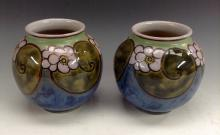 A pair of Royal Doulton stoneware ovoid vases, by Florrie Jones, the should