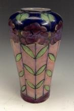 A Royal Doulton stoneware tapering cylindrical vase, applied with tall stem