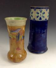 A Royal Doulton stoneware tapering cylindrical vase, tube lined with a sing