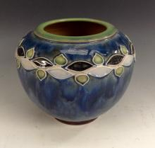 A Royal Doulton ovoid vase, by Florrie Jones, the tube lined shoulder simpl