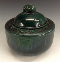 A Royal Doulton Chang type ribbed cylindrical tobacco jar, glazed throughou