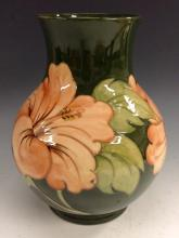 A Moorcroft Hibiscus pattern baluster vase, tube lined with large flowerhea