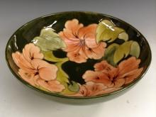 A Moorcroft Hibiscus pattern circular bowl, tube lined with large flowerhea