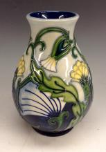 A modern Moorcroft pottery baluster vase, tubelined with yellow flowers on