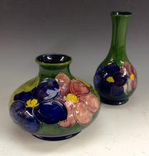 A Moorcroft Anemone squat vase, tubelined pink and purple flowers on a gree