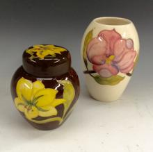A Moorcroft Bermuda ginger jar, tubelined yellow flowers on a brown ground,