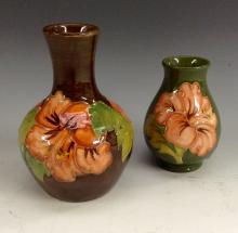 A Moorcroft Hibiscus baluster vase, tubelined pink hibiscus flowers on a br