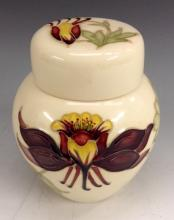 A Moorcroft Honeysuckle pattern ginger jar and cover, tube lined with large