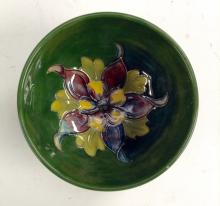 A Moorcroft Columbine circular dish, tubelined flower and foliage to the ce