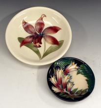 A Moorcroft circular dish,  tube line with a mauve orchid on a white ground