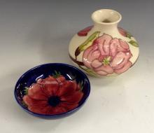 A Moorcroft Magnolia compressed baluster vase, tube lined with flowers in t