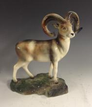 A Bretby model of a Mouflon, modelled on a rocky outcrop, 20cm high, impres