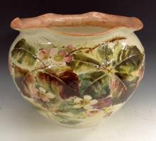 A large Bretby jardiniere, raised in impasto flowers and foliage, signed J