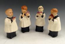 A set of four Bretby figures, The Choristers, probably modelled by Raymond