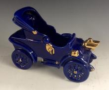 A Bretby novelty model of an early 20th century open top motor car, blue gl