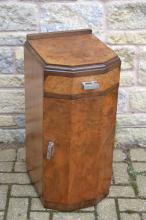 An Art Deco burr walnut bedside cabinet, of canted rectangular form, fitted