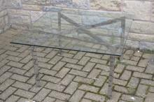 A Mies Van Der Rohe style Barcelona coffee table, chrome X frame stand, 91c