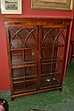 A reproduction mahogany china display cabinet