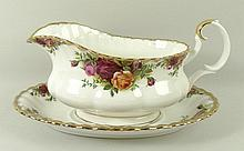 A Royal Albert porcelain part dinner and tea service decorated in the 'Old Country Roses' pattern, comprising a sauce boat and liner, eight dinner, dessert, side plates, soup bowls and dessert bowls, eight tea cups and saucers, nine coffee cans and