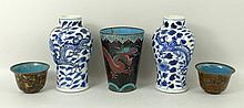 A pair of late 19th/early 20th century Chinese blue and white miniature baluster vases, decorated with dragons amongst foliage, 10cm, a pair of 19th century cloisonne cups, decorated with chrysanthemums and peonies, in a brown palette, with blue