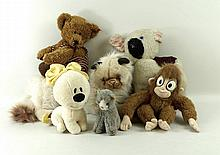 A large collection of soft toys, including a Steiff grey cat