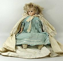 A bisque head doll, early 20th century, in its original clothes, boxed for Dickins & Jones, Regent Street W1.