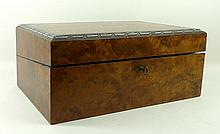 A Victorian burr walnut, rosewood and inlaid writing slope with two fitted inkwells, 41 by 28 by 17.5cm.