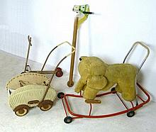 A 1940's painted basket weave doll's pram, a wooden hobby ho