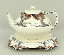 A Crown Ducal pottery part tea service decorated in the 'Orange Tree' pattern, comprising; tea pot and stand, a milk jug, sugar bowl, thirteen cups, fifteen saucers, fourteen side plates, three dessert plates, and two cake plates. (51)
