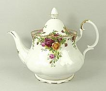A Royal Albert porcelain part tea service decorated in the 'Old Country Roses' pattern, comprising; teapot, cream jug, slop bowl, sugar bowl, milk jug, six cups, saucers and side plates, two sandwich saucers, two pin dishes, jam pot, and pepper