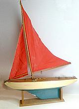 A wooden model pond yacht, Empress, complete with sails, rigging and stand, having painted hull and keel and polished slatted wooden deck with removable hatch.