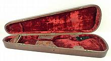 A 19th century mahogany violin case, with red velvet lined a
