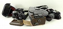 A Franke & Heidecke Rolleicord camera with Carl Zeiss 1:3,2 and 1:3,5 lenses, a Canon A-1 camera with a Skylight (1A) lens, and a Nikon AS camera with a Nikkor 135mm 1:2,6 lens. (3)