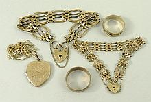 A 9ct gold four bar gate bracelet on a heart shaped padlock
