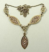 A 9ct two tone gold drop necklace, with Celtic design, 8.2g.
